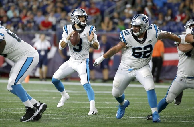 Carolina Panthers quarterback Will Grier (3) drops back to pass against the New England Patriots in the second half of an NFL preseason football game, Thursday, Aug. 22, 2019, in Foxborough, Mass. (AP Photo/Elise Amendola)