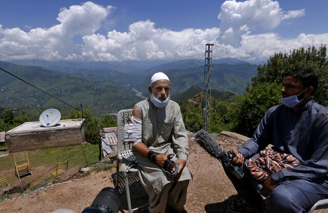 "Abdul Aziz, who was injured when shrapnel from an Indian mortar wounded his arm, talks to journalists in Chiri Kot sector near the Line of Control, that divides Kashmir between Pakistan and India, Wednesday, July 22, 2020. Villagers living along a highly militarized frontier in the disputed region of Kashmir have accused India of ""intentionally targeting"" civilians, but they are vowing that they would never leave their areas. Villagers say the fear of death is no longer present in their hearts after spending so many years in a state of shock and uncertainty. (AP Photo/Anjum Naveed)"
