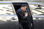 Samsung Electronics Vice Chairman Lee Jae-yong gets off a car upon his arrival at the Seoul High Court in Seoul, South Korea, Friday, Oct. 25, 2019. Billionaire Samsung scion Lee appeared in court for a retrial on corruption charges that partially fueled an explosive 2016 scandal that spurred massive protests and sent South Korea's then-president to prison. (AP Photo/Ahn Young-joon)