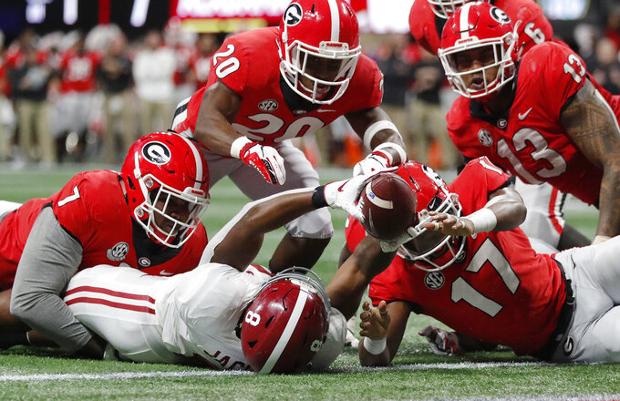 Alabama running back Josh Jacobs (8) scores a touchdown after he fumbled the ball against Georgia during the first half of the Southeastern Conference championship NCAA college football game, Saturday, Dec. 1, 2018, in Atlanta. (AP Photo/John Bazemore)