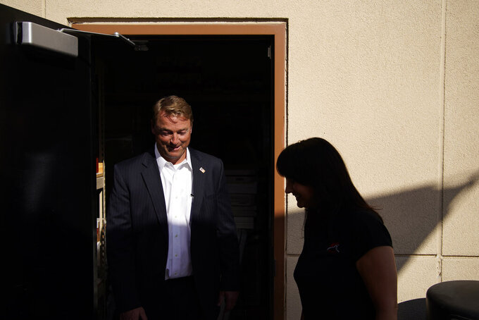 Former U.S. Sen. Dean Heller, left, tours Share Village Las Vegas with co-owner Shannon Kelly, right, after announcing a bid for governor of Nevada, Monday, Sept. 20, 2021, in Las Vegas. (AP Photo/John Locher)
