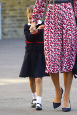 Britain's Princess Charlotte, left, arrives for her first day of school at Thomas's Battersea in London, with her mother Kate, Duchess of Cambridge, her father Prince William and her brother Prince George Thursday Sept. 5, 2019. (Aaron Chown/Pool via AP)