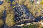 This Jan. 1, 2020 photo, shows a burned down animal house at the Zoo in Krefeld, Germany. Three woman are under investigation for launching paper sky lanterns blamed for setting off a fire that destroyed an ape house at the zoo in the first few minutes of the new year, killing more than 30 animals, officials said Thursday. (Christoph Reichwein/dpa via AP)