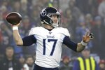 Tennessee Titans quarterback Ryan Tannehill passes against the New England Patriots in the first half of an NFL wild-card playoff football game, Saturday, Jan. 4, 2020, in Foxborough, Mass. (AP Photo/Elise Amendola)