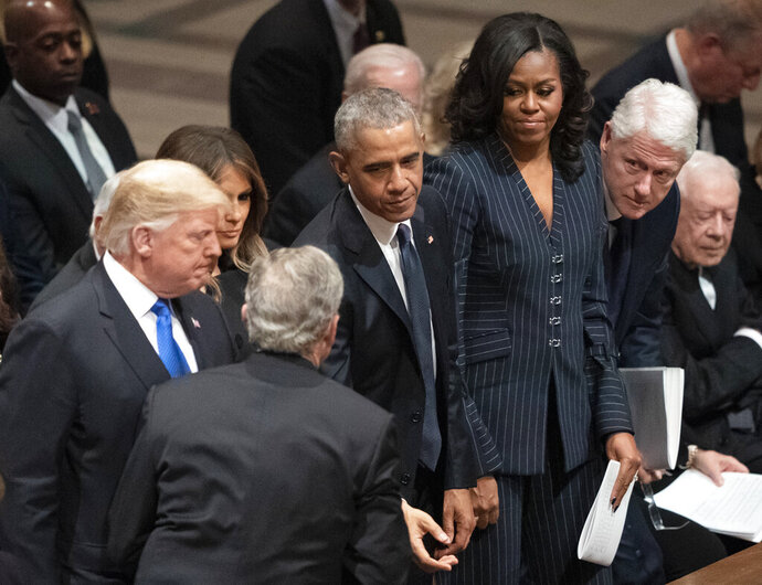 FILE - In this Dec. 5, 2018 file photo former President George W. Bush greets President Donald Trump, first lady Melania Trump, former President Barack Obama, Michelle Obama, former President Bill Clinton, former Secretary of State Hillary Clinton, and former President Jimmy Carter during a State Funeral for former President George H.W. Bush at the National Cathedral in Washington.(AP Photo/Carolyn Kaster, File)
