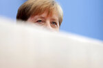 German Chancellor Angela Merkel addresses the media during her annual sommer press conference in Berlin, Germany, Friday, July 19, 2019. (AP Photo/Michael Sohn)