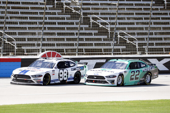 Chase Briscoe (98) and Austin Cindric (22) battle down the front stretch during a NASCAR Xfinity auto race at Texas Motor Speedway in Fort Worth, Texas, Saturday, July 18, 2020. (AP Photo/Ray Carlin)