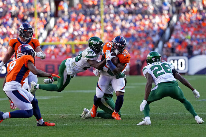 Denver Broncos runningback Damarea Crockett (28) is hit by New York Jets free safety Marcus Maye (20) during the second half of an NFL football game, Sunday, Sept. 26, 2021, in Denver. (AP Photo/Jack Dempsey)