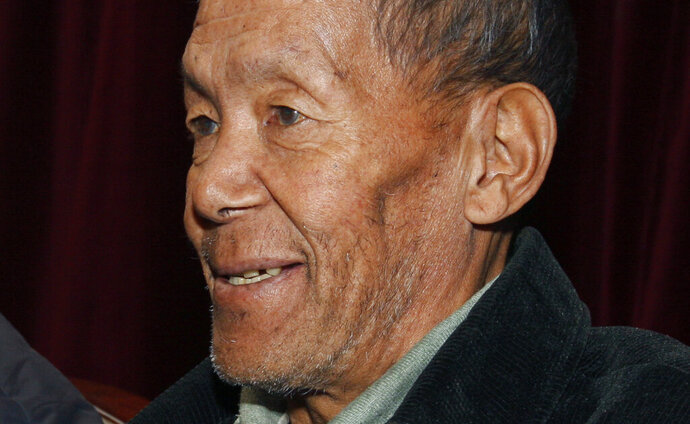 FILE- A Nov. 29, 2009 file photo of Ang Rita Sherpa during a press conference in Katmandu, Nepal. The veteran Nepalese Sherpa guide who was the first person to climb Mount Everest 10 times has died at the age of 72 after a long illness, family members said. (AP Photo/Binod Joshi, File)