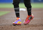 Boston Red Sox's Mookie Betts gets back to first base wearing custom cleats during the second inning of a baseball game against the San Diego Padres, Saturday, Aug. 24, 2019, in San Diego. (AP Photo/Denis Poroy)
