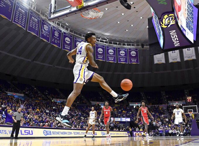LSU guard Marlon Taylor (14) celebrates his alley oop dunk on the way down in the first half of an NCAA college basketball game against Georgia, Wednesday, Jan. 23, 2019, in Baton Rouge, La. (AP Photo/Bill Feig)