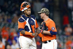 Houston Astros catcher Martin Maldonado, left, and closing pitcher Joe Smith congratulate each other after their win over the Texas Rangers after a baseball game Friday, May 14, 2021, in Houston. (AP Photo/Michael Wyke)