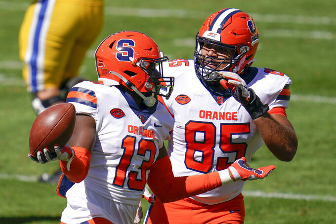Syracuse linebacker Mikel Jones (13) celebrates with Josh Black (85) after recovering a fumble when Pittsburgh running back Vincent Davis (22) missed a backward pass during the first half of an NCAA college football game, Saturday, Sept. 19, 2020, in Pittsburgh. (AP Photo/Keith Srakocic)