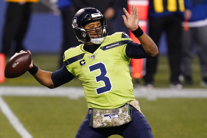 Seattle Seahawks quarterback Russell Wilson passes against the Arizona Cardinals during the first half of an NFL football game, Thursday, Nov. 19, 2020, in Seattle. (AP Photo/Elaine Thompson)