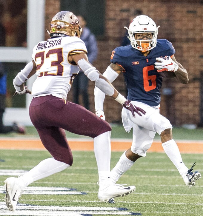 Illinois wide receiver Dominic Stampley (6) runs the ball after making a catch as Minnesota's Jordan Howden (23) defends in the second half of a NCAA college football game Saturday, Nov. 3, 2018, in Champaign, Ill. (AP Photo/Holly Hart)