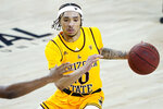 Arizona State guard Jaelen House (10) looks to pass against Oregon State during the second half of an NCAA college basketball game, Sunday, Feb. 14, 2021, in Tempe, Ariz.(AP Photo/Matt York)