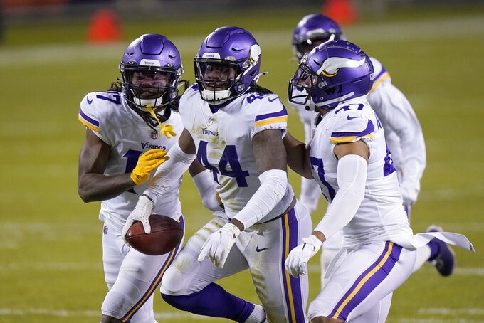 Minnesota Vikings safety Josh Metellus (44) celebrates with teammates after recovering a fumbled punt return by Chicago Bears' Dwayne Harris during the second half of an NFL football game Monday, Nov. 16, 2020, in Chicago. (AP Photo/Nam Y. Huh)