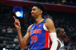 Detroit Pistons forward Christian Wood (35) reacts after a dunk during the first half of an NBA basketball game against the Sacramento Kings, Wednesday, Jan. 22, 2020, in Detroit. (AP Photo/Carlos Osorio)