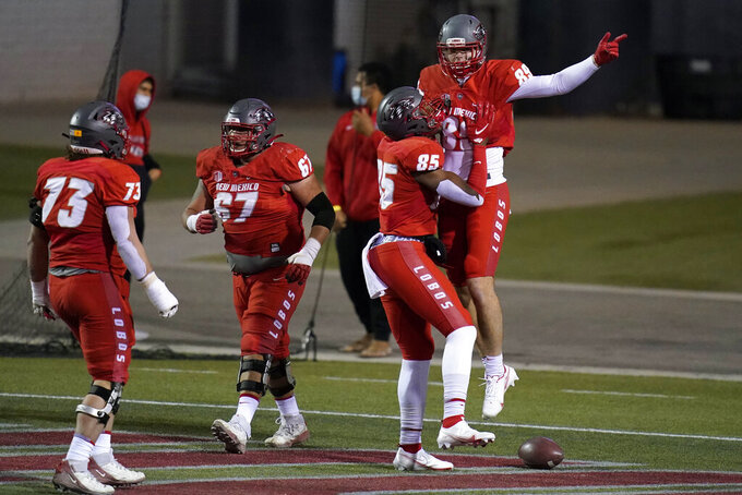 New Mexico tight end Conner Kinslow, right, celebrates after scoring a touchdown against Fresno State during the second half of an NCAA college football game Saturday, Dec. 12, 2020, in Las Vegas. (AP Photo/John Locher)