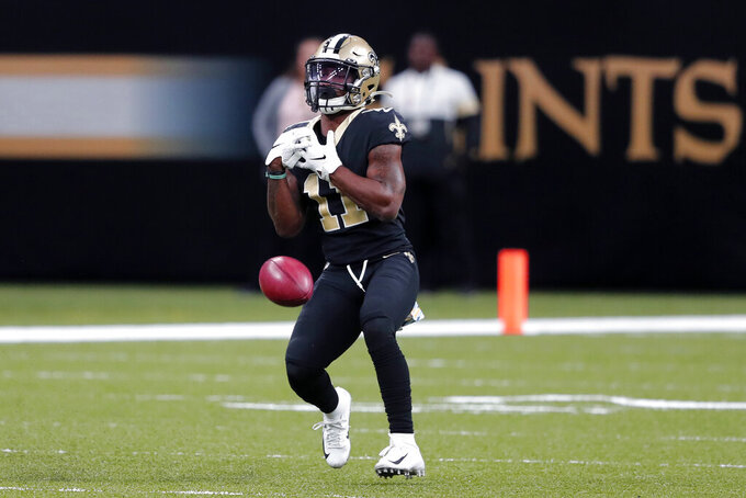 New Orleans Saints wide receiver Deonte Harris (11) drops a punt in the first half of an NFL football game against the Tampa Bay Buccaneers in New Orleans, Sunday, Oct. 6, 2019. (AP Photo/Bill Feig)