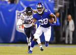 FILE - In this Friday, Aug. 16, 2019, file photo, New York Giants running back Paul Perkins (28) runs the ball against the Chicago Bears during the second quarter of a preseason NFL football game in East Rutherford, N.J. Perkins is trying to make the team after missing last season with a torn pectoral muscle. (AP Photo/Adam Hunger, File)