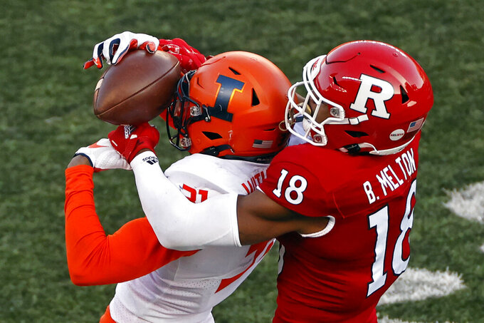 Illinois defensive back Devon Witherspoon (31) makes an interception in front of Rutgers wide receiver Bo Melton (18) during the second half of an NCAA college football game, Saturday, Nov. 14, 2020, in Piscataway, N.J. (AP Photo/Adam Hunger)