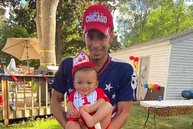 FILE - This photo provided by Ben Crump Law, PLLC. shows Daunte Wright and his son, Daunte Jr., at his first birthday party. Wright, 20, was killed during a traffic stop bya white suburban Minneapolis police officer on Sunday, April 11, 2021. (Ben Crump Law, PLLC. via AP)