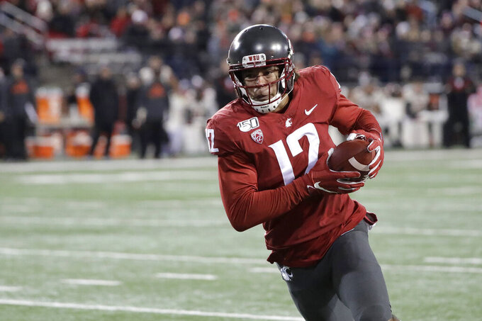Washington State wide receiver Dezmon Patmon runs for a touchdown after making a catch during the first half of the team's NCAA college football game against Oregon State, Saturday, Nov. 23, 2019, in Pullman, Wash. (AP Photo/Ted S. Warren)