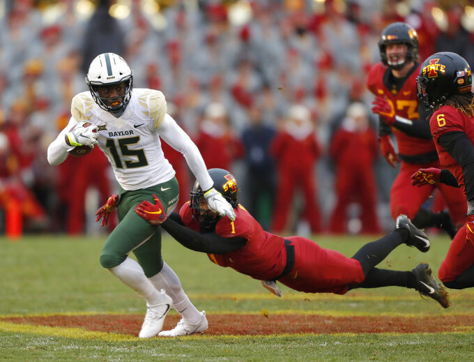 Baylor wide receiver Denzel Mims, left, runs the ball as he is tackled by Iowa State defensive back D'Andre Payne, center, during the first half of an NCAA college football game, Saturday, Nov. 10, 2018, in Ames. (AP Photo/Matthew Putney)