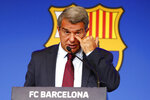 FC Barcelona club President Joan Laporta scratches his face during a news conference in Barcelona, Spain, Friday, Aug. 6, 2021. Barcelona announced on Thursday, Aug. 5, 2021 that Lionel Messi will not stay with the club. He is leaving after 17 successful seasons in which he propelled the Catalan club to glory, helping it win numerous domestic and international titles since debuting as a teenager. (AP Photo/Joan Monfort)
