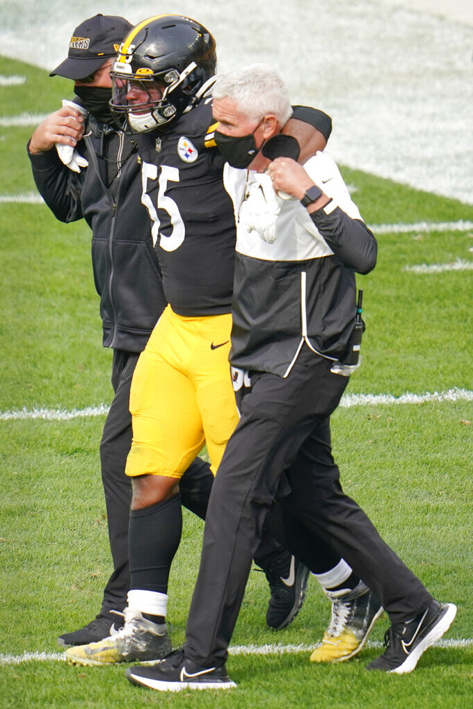 Pittsburgh Steelers inside linebacker Devin Bush (55) is helped from the field after he was injured in the first half of an NFL football game against the Cleveland Browns, Sunday, Oct. 18, 2020, in Pittsburgh. Steelers head coach Mike Tomlin said in the post game news conference that Bush suffered a significant injury to a knee on the play. (AP Photo/Gene J. Puskar)