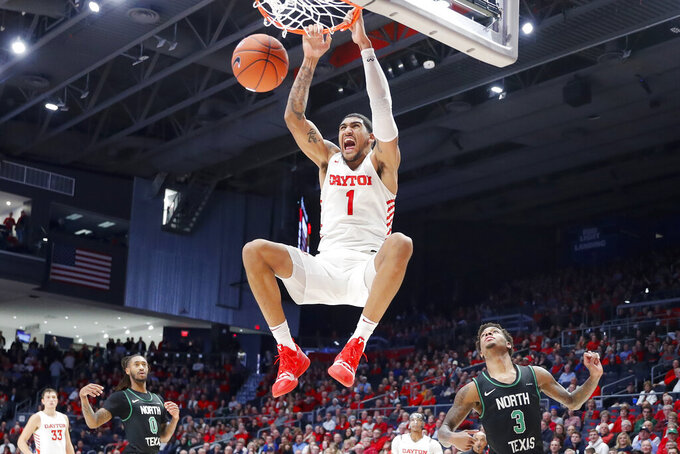 FILE - In this Dec. 17, 2019, file photo, Dayton's Obi Toppin (1) dunks as North Texas' Javion Hamlet (3) looks on during the second half of an NCAA college basketball game in Dayton, Ohio. Toppin is the lone unanimous first-team choice to The Associated Press men's college basketball All-America team, Friday, March 20, 2020. (AP Photo/John Minchillo, File)