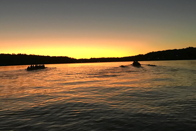 The UConn women's rowing team works out on Wangumbaug Lake in this September 2019 photo taken in Coventry Lake, Conn. The school's decision to cut the program is designed to help cut by $10 million the school's $43 million athletic department deficit as it deals with falling revenue during the COVID-19 pandemic. (Jen Sanford via AP)