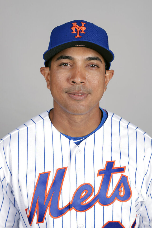 FILE - This is a 2019 photo showing Luis Rojas of the New York Mets baseball team. The New York Mets are finalizing a multiyear agreement with quality control coach Luis Rojas to make him the team's new manager, general manager Brodie Van Wagenen said Wednesday, Jan. 22, 2020. Rojas would replace Carlos Beltrán, who left the team last week before managing a single game as part of the fallout from the Houston Astros' sign-stealing scandal. (AP Photo/John Raoux, File)