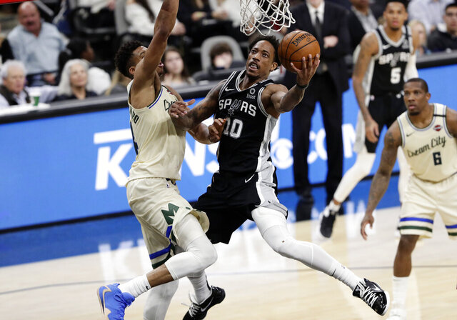 San Antonio Spurs guard DeMar DeRozan (10) scores against Milwaukee Bucks forward Thanasis Antetokounmpo, left,  during the second half of an NBA basketball game in San Antonio, Monday, Jan. 6, 2020. (AP Photo/Eric Gay)