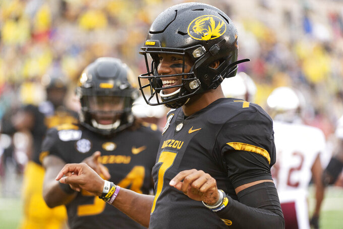 Missouri quarterback Kelly Bryant celebrates his touchdown with teammates during the first half of an NCAA college football game against Troy Saturday, Oct. 5, 2019, in Columbia, Mo. (AP Photo/L.G. Patterson)