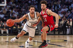 Georgia Tech guard Jose Alvarado (10) drives past North Carolina State guard Devon Daniels (24) in the first half of an NCAA college basketball game Saturday, Jan. 25, 2020, in Atlanta. (AP Photo/Danny Karnik)