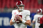 Alabama quarterback Mac Jones (10) warms up before the first half of the Southeastern Conference championship NCAA college football game against Florida, Saturday, Dec. 19, 2020, in Atlanta. Heisman Trophy finalists Mac Jones and DeVonta Smith have been selected to The Associated Press All-America team, Monday, Dec. 28, 2020, leading a contingent of five Alabama players on the first-team offense. (AP Photo/Brynn Anderson)
