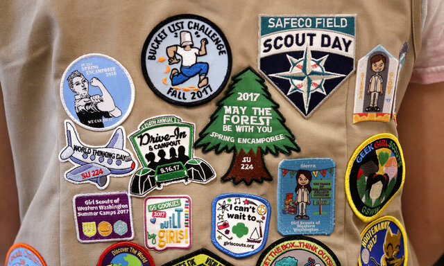 FILE - In this June 18, 2018, file photo, patches cover the back of a Girl Scout's vest at a demonstration of some of their activities in Seattle. Girl Scouts of the United States of America claim the century-old organization is in a