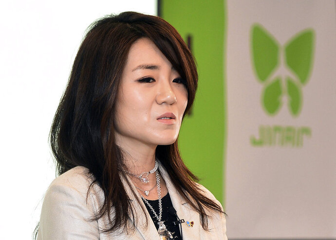 In this June 27, 2014, photo, Korean Air senior Vice President Cho Hyun-min, also known as Emily Cho, speaks during a press conference in Seoul, South Korea. Korean Air Lines said Monday, April 16, 2018, it has suspended Cho from her marketing work after she threw a tantrum at a business meeting, triggering public outrage and a police investigation. (Kang Jin-hyung/Newsis via AP)