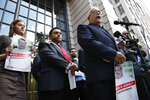 Rep. Gerry Connolly, D-Va., right, speaks during a news conference about journalist Jamal Khashoggi's disappearance in Saudi Arabia, Wednesday, Oct. 10, 2018, in front of the Washington Post in Washington. (AP Photo/Jacquelyn Martin)