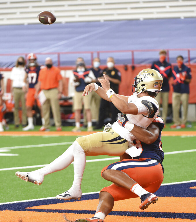 Georgia Tech quarterback Jordan Yates (13) gets rid of the ball quickly against Syracuse during an NCAA college football game, Saturday, Sept. 26, 2020, at the Carrier Dome in Syracuse, N.Y. (Dennis Nett/The Post-Standard via AP)