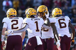Minnesota quarterback Tanner Morgan (2), wide receiver Demetrius Douglas (82), and wide receiver Tyler Johnson (6) congratulate running back Rodney Smith (1) on his touchdown during the first half of an NCAA college football game against Rutgers Saturday, Oct. 19, 2019, in Piscataway, N.J. (AP Photo/Sarah Stier)