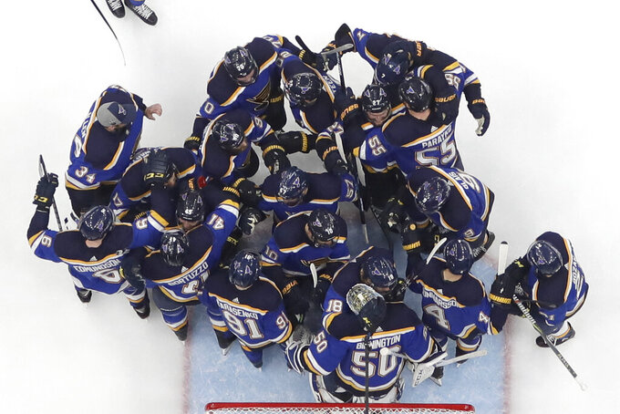 FILE - In this Tuesday, May 21, 2019 file photo, the St. Louis Blues celebrate after beating the San Jose Sharks in Game 6 of the NHL hockey Stanley Cup Western Conference final series, in St. Louis. The Blues won 5-1 to win the series 4-2 and earn a berth in the Stanley Cup Finals. (AP Photo/Jeff Roberson)