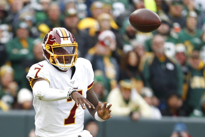 Washington Redskins' Dwayne Haskins throws during the first half of an NFL football game against the Green Bay Packers Sunday, Dec. 8, 2019, in Green Bay, Wis. (AP Photo/Matt Ludtke)