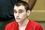 FILE - In this Dec. 10, 2019 Nikolas Cruz appears at a hearing in Fort Lauderdale Fla. The death penalty trial of Cruz, the man charged with killing 17 people at a Florida high school is off indefinitely because of restrictions related to the coronavirus. Broward Circuit Judge Elizabeth Scherer said Monday, June 22, 2020, in a hearing held remotely that it's not even clear when the courthouse will reopen to the public. It's been closed since March 16.  Cruz is charged with fatally shooting 17 people and wounding 17 others at Marjory Stoneman Douglas High School on Valentine's Day 2018. (Amy Beth Bennett/South Florida Sun-Sentinel via AP, Pool)
