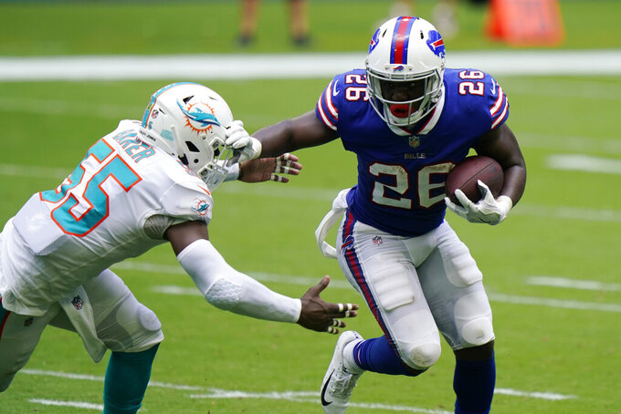 Miami Dolphins outside linebacker Jerome Baker (55) attempts to stop Buffalo Bills running back Devin Singletary (26), during the first half of an NFL football game, Sunday, Sept. 20, 2020 in Miami Gardens, Fla. (AP Photo/Wilfredo Lee)