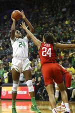 Oregon's Ruthy Hebard, left, shoots over United States' Napheesa Collier during the first half of an exhibition basketball game in Eugene, Ore., Saturday, Nov. 9, 2019. (AP Photo/Chris Pietsch)
