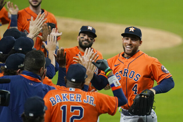 Houston Astros George Springer (4) and Jose Altuve celebrates with his teammates after winning Game 6 of a baseball American League Championship Series against the Houston Astros, Friday, Oct. 16, 2020, in San Diego. The Astros defeated the Rays 7-4 to tie the series 3-3. (AP Photo/Gregory Bull)