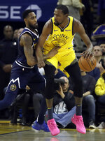 Denver Nuggets' Will Barton, left, guards Golden State Warriors' Kevin Durant during the first half of an NBA basketball game Friday, March 8, 2019, in Oakland, Calif. (AP Photo/Ben Margot)